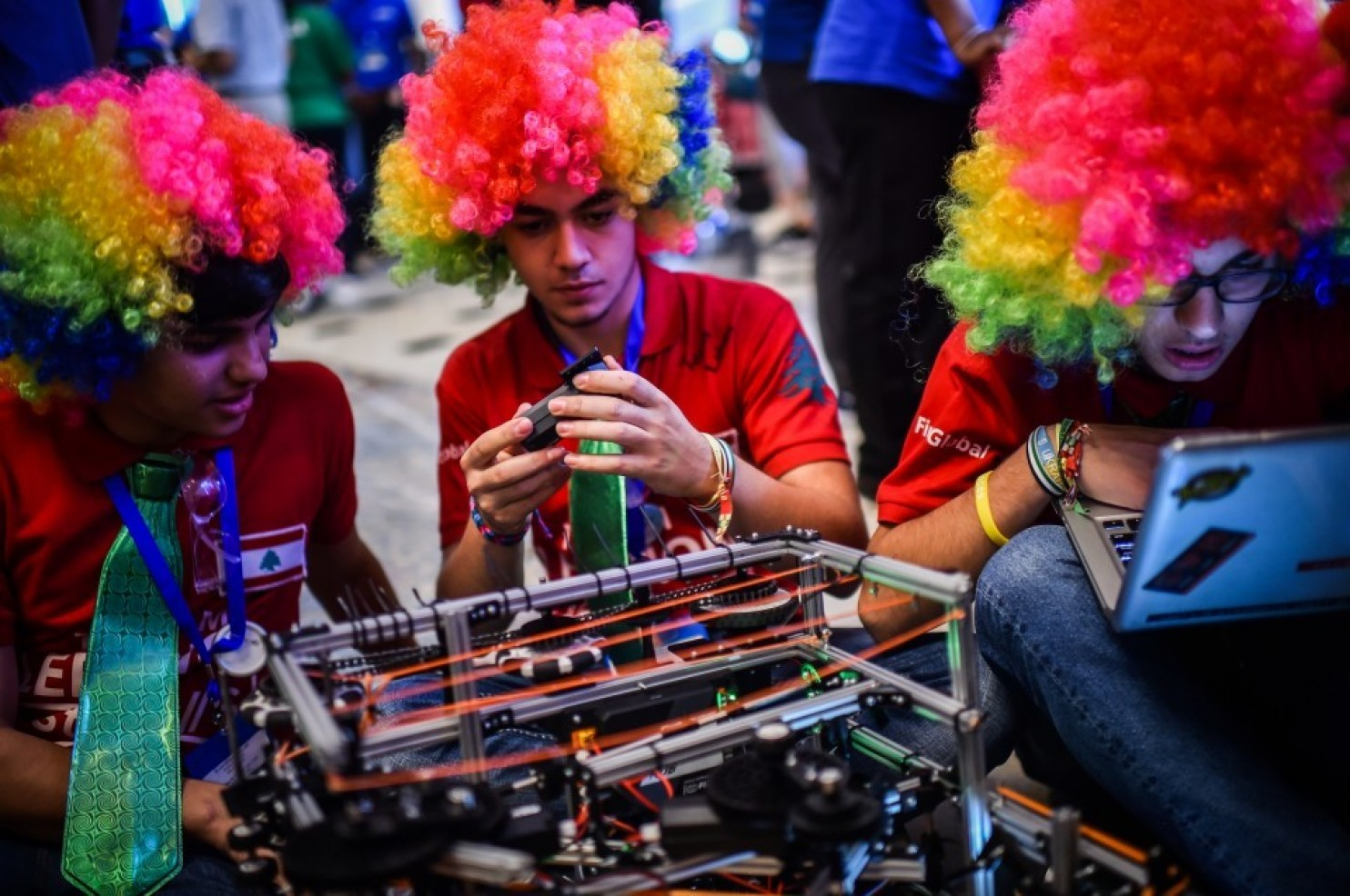 Team Lebanon member, from left, Shadi El-Aridi, Wissam Malaeb and Kareem Kawtharani fix their robot during the FIRST Global Challenge, international annual robotics game on. (Photo by Salwan Georges/The Washington Post)