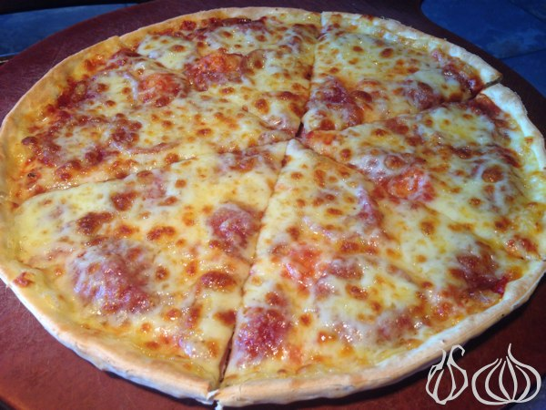 This is the only pizza served on a wooden serving pan  Pizza_Hut_Dine_In_Lebanon34