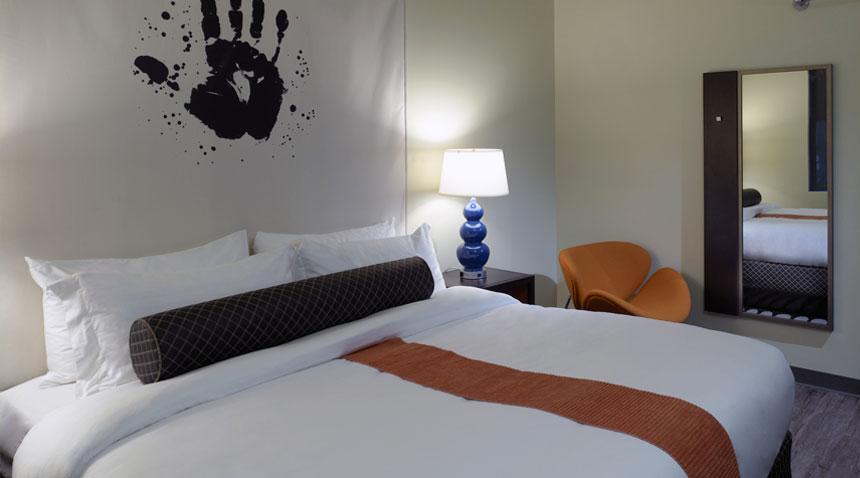 acme-hotel-company-illinois-king-suite-bedroom